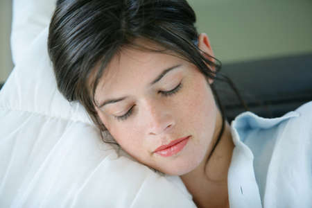 Young woman resting on a sofa Stock Photo - 13915396