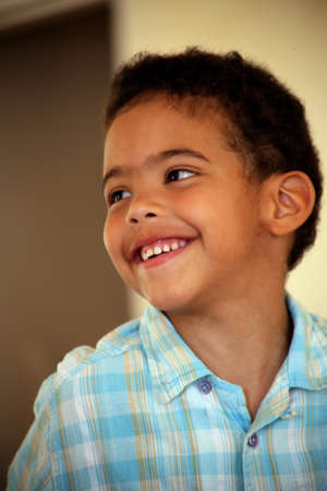 intermarriage: Portrait of happy little boy Stock Photo