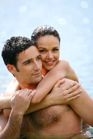 Couple hugging at the seaside photo