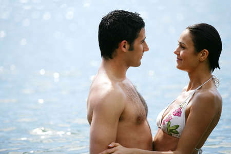 couple embracing in the water photo