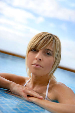 Blond woman in a swimming-pool Stock Photo - 13915125