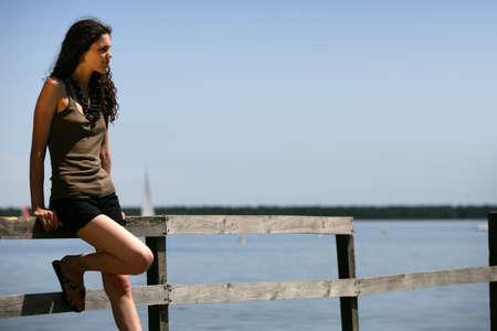 Woman stood alone on jetty photo