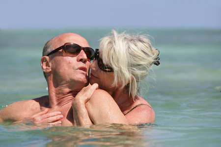 Woman and man embracing in the water Stock Photo - 13915220