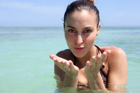 young woman swimming in the sea photo