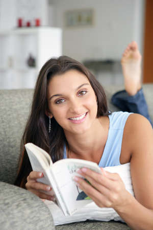 Brunette relaxing with book Stock Photo - 13914759