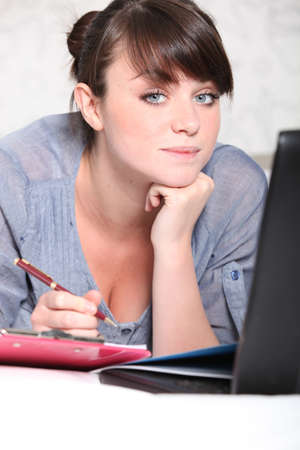 Student working on an essay Stock Photo - 13915216