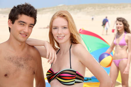 Teenagers on the beach photo