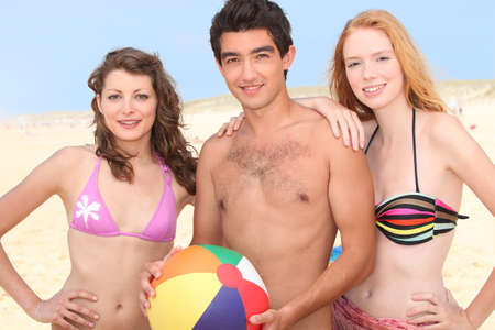 Young people on the beach photo