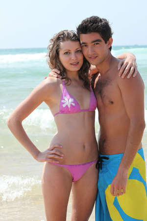boardwalk: Young couple on the beach