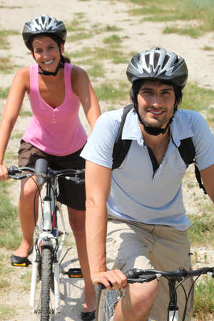 trail bike: Couple enjoying leisurely bike ride