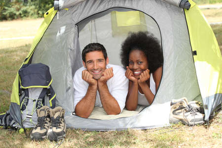 accomplices: couple in a tent