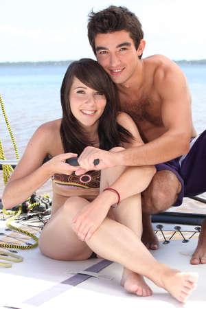 skipper: Closeup of a young couple sailing a catamaran Stock Photo