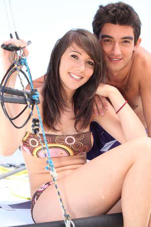 Teenage couple on yacht photo