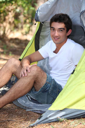 Camper sitting in his tent Stock Photo - 13959774