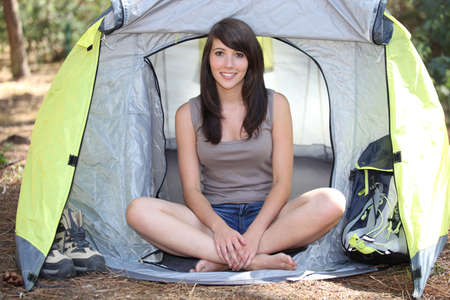 Brunette girl in front of tent photo