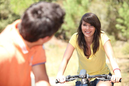Smiling couple on a bicycle Stock Photo - 13962064