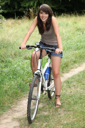 sandal tree: young woman doing mountain bike in the country Stock Photo