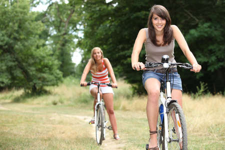 blonde streaks: girls on bikes Stock Photo