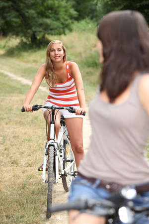 Teenagers cycling photo
