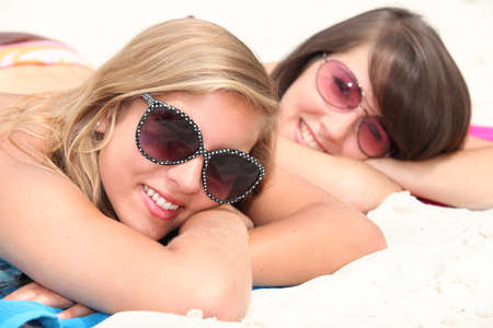 two young women on the beach photo