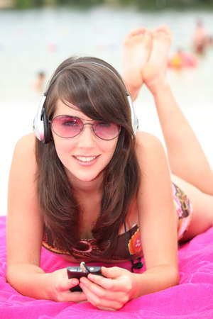 Brunette girl with headphones photo