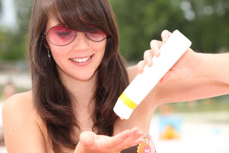 suns: Young woman protecting herself from the suns harmful rays