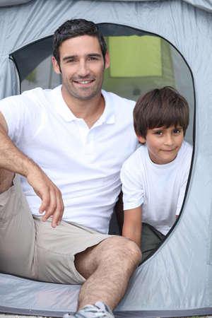 Child camping with his father photo