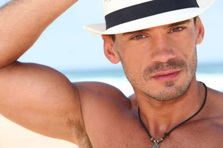 brawny: Muscled young man with a hat Stock Photo