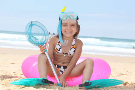 child swimsuit: Girl on the beach
