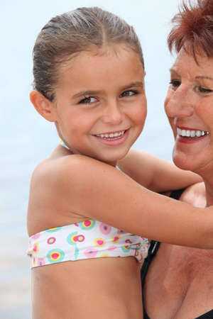 flattery: Grandmother with child in her arms Stock Photo