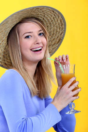 vacationer: Woman drinking juice Stock Photo