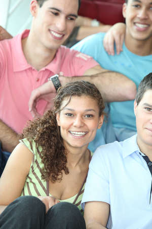 pales: Group of teenage friends sat together Stock Photo