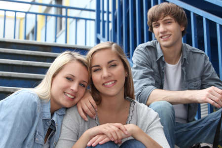 Teenagers sat on the steps Stock Photo - 13959760