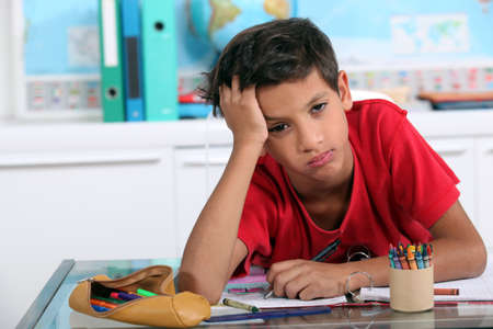 country boy: Little boy bored in art class Stock Photo