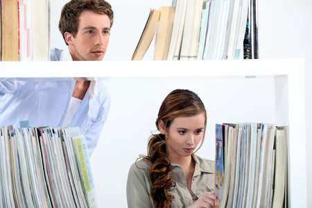 Couple stood in library photo