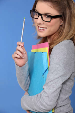 armful: Student in glasses with an armful of files Stock Photo