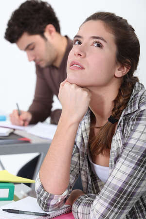 Young woman daydreaming in class photo
