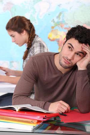 non uniform: Bored student in classroom Stock Photo
