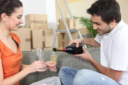 Couple toasting the new house photo