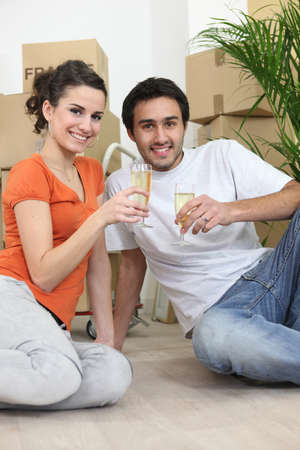Couple sat in new apartment photo