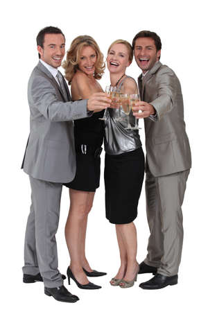 Two couples celebrating with champagne photo