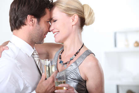 A couple celebrating with a glass of champagne Stock Photo - 13960057