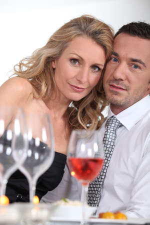 dressy: Dressy couple having dinner Stock Photo