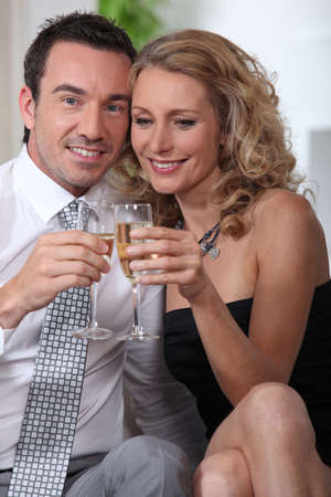 Midshot of couple drinking champagne photo