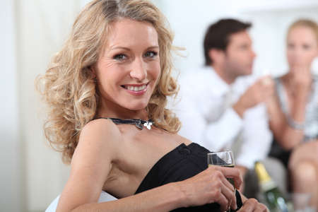 Blond woman with glass of champagne Stock Photo - 13960234