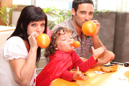 Family inflating balloons for Halloween Stock Photo - 13974489