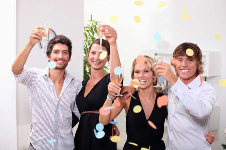 Two couples celebrating together Stock Photo - 13974334