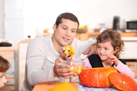 a father and his daughter at Halloween time photo