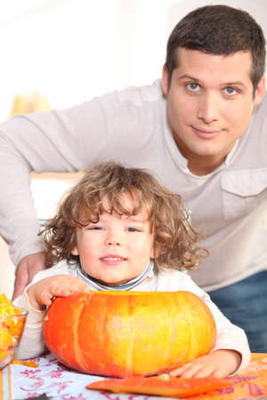 closely cropped: young man, kid and pumpkin