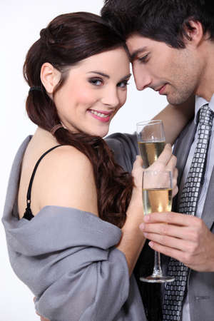 implies: Couple toasting with champagne